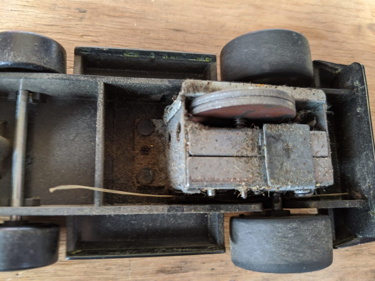 A photograph of a disassembled Tonka Clutch Popper